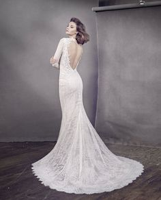 Style 3652  Lazaro bridal gown - Ivory Chantilly lace trumpet bridal gown over nude sparkle net and cashmere chiffon, Venice lace appliqué accent bodice, V neckline with open back, shear long lace sleeve, chapel train.