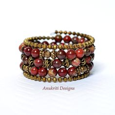 This memory wire bracelet is made with beautiful 8mm jasper beads and antique brass spacer beads. The jasper beads are brick colored with a