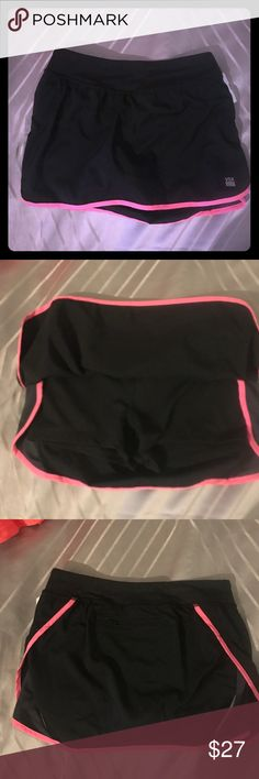 Victoria's Secret Workout Skort Black with pink side stripes and aback pocket. New without tags. Victoria's Secret Skirts