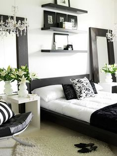 Contemporary Bedroom Interior Design Ideas Pictures. Black and white with mirrors, chandeliers, and a platform bed. Love this!