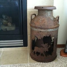 How neat is this old milk jug with designs cut out? Bought it for our living room. Going for an outdoorsy, cabin type of decor. Cabin Design, Rustic Design, Rustic Decor, Rustic Charm, Country Living Decor, Rustic Living Room Furniture, Old Milk Jugs, Milk Cans, Moose Decor