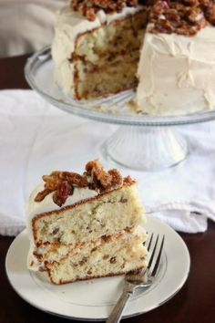 Pecan Praline Cake ~ This is a great southern inspired cake with flavors of Bourbon, Pralines, and surrounded by a vanilla cream cheese frosting.