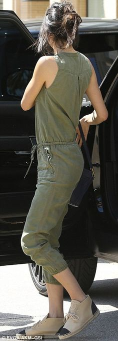Showing her style: The reality star donned a sleeveless military green jumpsuit along with...