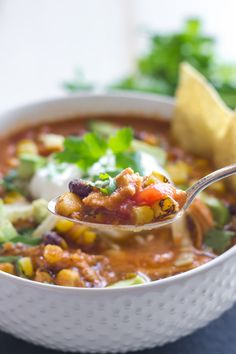 This Chicken Tortilla Soup is easy, healthy, and a little spicy too. You'll love how fast it comes together in your crockpot!