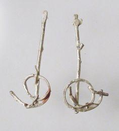 Earrings from found copper, melted silver. Roxy Lentz