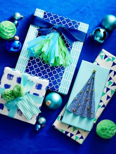 Your presents will stand out among the rest with this #DIY folded paper tree wrapping // #hgtvmagazine // http://www.hgtv.com/design/make-and-celebrate/holidays/festive-diy-holiday-gift-wrapping-ideas?soc=pinterest