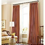 Pinch-pleat curtains from JC Penney in warm copper tone.