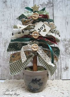 A Fabric Strip Christmas Tree is part of Country Fabric Crafts - Melissa posted a really fun little project on Papertrey Ink's Make it Monday challenge this week, and the country in me had to give it a go Handmade Christmas Decorations, Diy Christmas Ornaments, Diy Christmas Gifts, Christmas Projects, Christmas Fun, Vintage Christmas, Christmas Wreaths, Beautiful Christmas, Primitive Christmas Tree