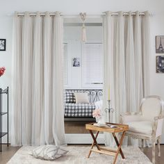 These elegant and sophisticated dotted lace overlay blackout curtains are a luxurious addition to your home decor.