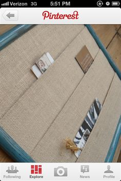 Burlap...use jute cord to hold picture in place (like the seams here) so that u dont have to use glue or adhesives to mount your pictures