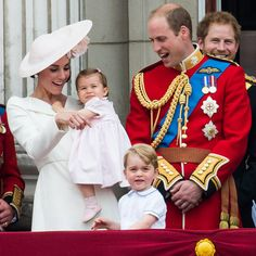 Pretty in pink: Princess Charlotte makes her Buckingham Palace balcony debut alongside brother George as the royals watch an RAF fly-past during the Queen's official 90th birthday celebrations