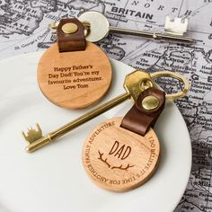Personalised Dad's Family Adventure Keyring. A beautiful wood and leather luxury keyring, perfect for dads who love an adventure. The ideal gift for Father's Day, dad's birthday, a stocking filler or just because. The keyring is engraved with the message 'I do believe it's time for another family adventure' around the circumference of the wood. 'Dad' is also written in the middle with a pair of antlers etched underneath.