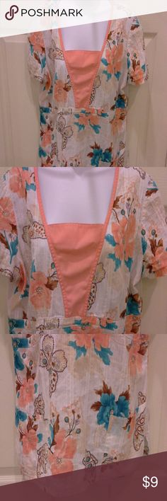 Baby Phat scrub top Teal, peach, wht, tan flowers & butterflies.  2 front pockets, tie in back.  In excellent condition. Baby Phat Tops