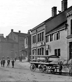 0384 Towngate in Meltham c1910 with The Swan Inn in the background.