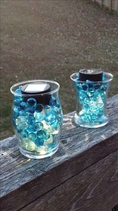Take a used candle jar, an outdoor solar light and glass beads. It's a great outdoor decoration for patio railings.