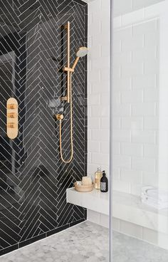 Black herringbone tile feature wall in shower