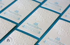 Letterpress with blind deboss and one color.