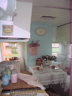 pretty and cottage cozy camper. Trey might shoot me if I did this to our camper!  Plus it would get filthy and drive me crazy!  But I like the idea of painting the walls and appliances!