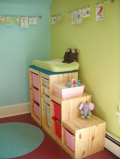 IKEA Trofast storage for toys and doubles as a changing table! GENIUS!