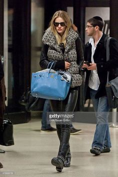 Rosie Huntington Whiteley is seen at Los Angeles International Airport on January 23, 2011 in Los Angeles, California.