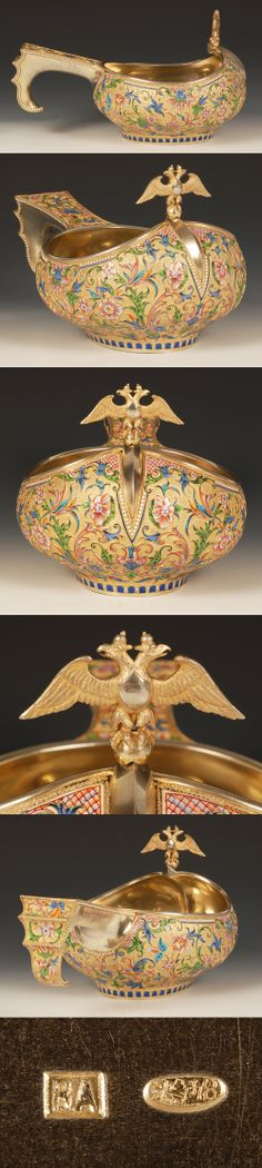 A Russian silver gilt and shaded cloisonne enamel kovsh, by Vasilly Agafonov, Moscow, circa 1896-1908. Of traditional form, the raised prow with an Imperial double headed eagle finial, the body enameled with stylized scrolling foliage in shades of blue, yellow, green and tan against a gilt stippled ground, the stepped hook handle similarly decorated.