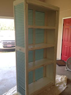 Bookcase surrounded with shutters