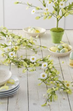 Easter table decorations: all the essentials: Bring some flower power to your table decorations with this beautiful daisy garland, epitomising spring. With white and yellow daisy flowers, arrange the garland as you wish for a spectacular Easter display. It's not only ideal for your table, but shelves or mantlepieces too. (Daisy Garland, £25, The Contemporary Home). Find more Easter ideas at housebeautiful.co.uk