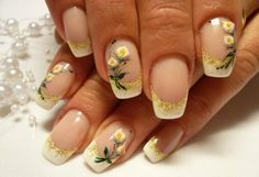 White french tips with gold accent and beautiful white calla lily flower details.  Very elegant and sophisticated nail art design.