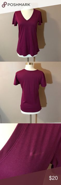 "Nike Dri Fit Regular Fit Tee Shirt Plum colored Dri Fit short sleeved tee. V neck . Lightweight. 100% polyester. 25"" shoulder to bottom. 17"" armpit to armpit. Nike Tops Tees - Short Sleeve"