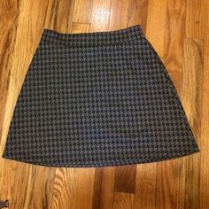 "UO Pins and Needles Gray Houndstooth A-line Skirt Black and gray stretchy houndstooth print skirt in A-line shape with black elastic insert at back waistband. Exposed back zipper. Has a knit feel to it. 99% polyester and 1% spandex. Made in USA. 15.5"" length, waist is 11.75"" to 14.5"". New and has never been worn. Urban Outfitters Skirts A-Line or Full"