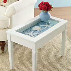 Glass-Topped Seashell Table Project Tutorial Hmm, Something like this might be cute in the living room.