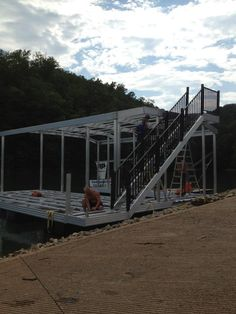 North Georgia Boat Lift & Marine Construction Company completed work on a brand new CAT 5 dock earlier this week. This dock, installed at Lake Fontana, features a standard single-slip combined with a wide-side to house the owner's boat. Ironwood decking was used in the construction of the main dock, the gangway also sporting it. Wahoo bumpers line the inside of the slip, protecting the boat from any damage. The upper level consists of a deck and roof. Boat Lift, Decking, Blue Ridge, Maine, Georgia, Construction, Cat, House, Building
