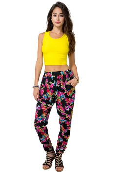 Floral Pop Pant | Stop being a wallflower and standout! A woven pair of joggers featuring vivid floral print throughout. Elasticized waist. Finished leg openings.