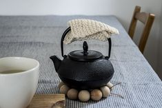 Alessandra Taccia's simple & clever design of a teapot coaster
