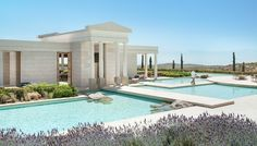 Discover Amanzoe, a luxury hilltop hideaway hotel surrounded by undulating olive groves on the unspoilt east coast of Greece's Peloponnese near Porto Heli.