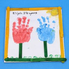 craftprojectideas.com - Tulip Handprint Frame Great Mother's Day or Grandparent gift
