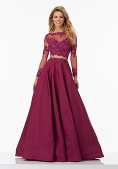 Two-Piece Prom Dress with Long Sleeved Lace on Net Top and A-Line Taffeta Skirt. Delicately Beaded Bodice. Zipper Back Closure. Colors Available: Watermelon, Berry