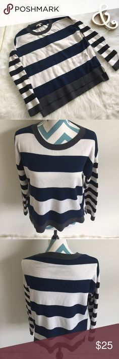 Banana Republic Sweater Super cute cream and navy blue stripped sweater. Fits oversized. High low design. Made with cotton, viscose, and nylon. Super soft material. No flaws! Banana Republic Sweaters