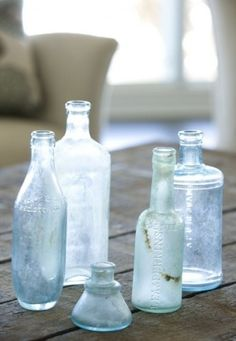Here's the key to making collections work: power in numbers. And that's especially true for the flea market finds and vintage castoffs that tend to populate cottage-style rooms. If they look too scattered, so will the space. Massed together, these glass bottles have a collective impact.