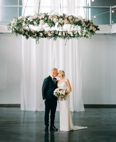 Gorgeous hanging floral installation: http://www.stylemepretty.com/little-black-book-blog/2015/08/25/romantic-industrial-minneapolis-wedding-with-swedish-traditions/ | Photography: Geneoh - http://geneoh.com/