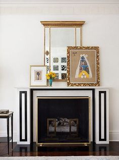 Black and white graphic contemporary fireplace with gallery shelf on mantle above.