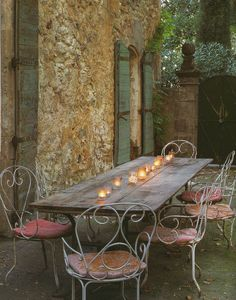 french courtyard, rustic chic. I love to be sipping wine right here