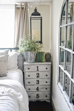 Lantern lighting in the guest bedroom. A lantern hanging on each side of the bed creates a focal point & extra lighting.