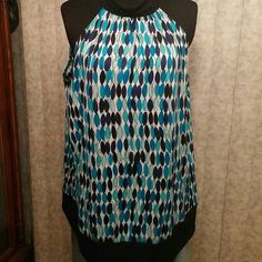 New listing! Adorable halter top Cute halter style top.  Ties closed behind the neck.  Excellent condition. Maurices Tops Blouses