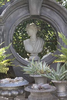 Love the old frame...and the urns and the bust.