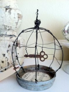 Vintage Zinc Canning Jar Lid Wire Birdcage by TrueNorthInteriorDes, $25.00 so very clever!