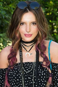 """Kendall Jenner Wears Glitter In An Unexpected Place — Plus, Other Coachella Makeovers #refinery29  http://www.refinery29.com/2016/04/108592/celebrity-coachella-beauty-looks#slide-4  We're still trying to wrap our heads around Bella Thorne's bohemian twisted """"plaits,"""" which she later traded in for a fun purple wig. ..."""