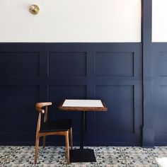 dining, restaurant, kitchen, interiors, navy wall, patterned tile floor
