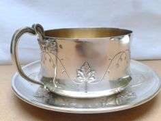 Art nouveau period, French 1st standard (.950 fine) silver chocolate cup and saucer with leaf and vine motif, by Edouard Fournemet, c1905 (vervene10)