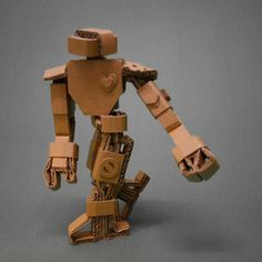 Items similar to Cardboard Articulated Robot on Etsy Paper Robot, Cardboard Robot, Cardboard Sculpture, Cardboard Paper, Cardboard Furniture, Cardboard Crafts, Paper Toys, Paper Crafts, Cardboard Playhouse